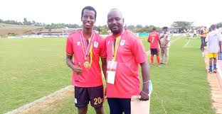 Alpha Thierry poses with the gold Medal  after helping the Uganda Hippos to win the 2020 CECAFA U20 Championship.